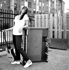 Dagna B&W Portrait with Guitar and Keyboard 2 (neohypofilms) Tags: street city portrait urban blackandwhite bw music woman white art 120 film girl lady female trash pose hair square photography blackwhite junk keyboard shoes downtown industrial guitar cleveland piano posing blouse organ clogs heels series medium format junkyard scrapyard scrap mules hassalblad neohypofilms cinehypofilms