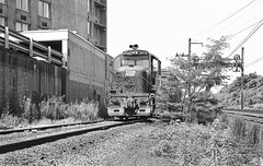 Ivey City Railroad Yard local area freight service is performed by a train led with a chop-nose Alco RS3M locomotive # 9951, still wearing it's former owners PC logo, in Washington, D.C., June 1976 (alcomike43) Tags: old railroad blackandwhite bw classic yard train vintage ties spur hotel washingtondc photo pc track diesel engine historic negative photograph rails locomotive siding ballast catenary rightofway dieselengine conrail alco electrification mainline no