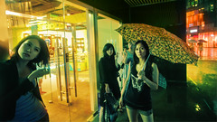 Four Girls (Jonathan Kos-Read) Tags: china city girls storm wet rain yellow night umbrella reflections asian neon crossprocess chinese beijing lonely    raining sanlitun bigcity goldenratio  chinesestreet chinesegirl streetcandid   chinesegirls sigma20mmf18exdg beijingstreet   20mmf18exdg nikond700 chinastreetphotography wetchinesegirls