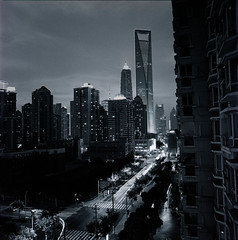 Pudong Night Life (yui503cx) Tags: china city light bw building night zeiss 50mm shanghai wine xp2 pudong ilford distagon hassel 503cx