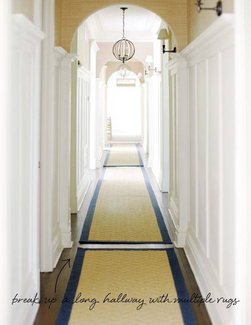 in the details long hallway multiple rugs