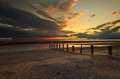 Low Tide (.Brian Kerr Photography.) Tags: sunset seascape beach clouds canon landscape coast sand pebbles shore cumbria lowtide posts solway galloway rockpool allonby eos5dmkii