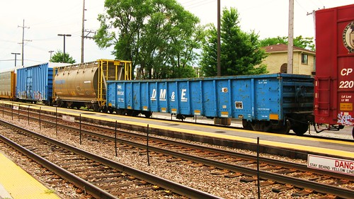 A blue former Dakota, Minnesota & Eastern Railroad gondola car in transit.  River Grove Illinois USA. Sunday, July 24th, 2011. by Eddie from Chicago