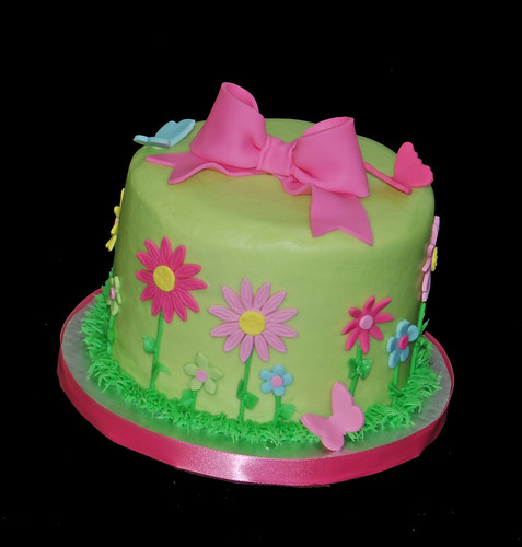 baby shower cupcake tower with butterflies and flowers - pinks, greens, blues, yellows