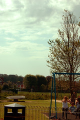 dyke road park. (Axtell Harris) Tags: park sky people clouds digital photography daylight brighton swings swing photograph swingset dustbin dykeroad dykeroadpark