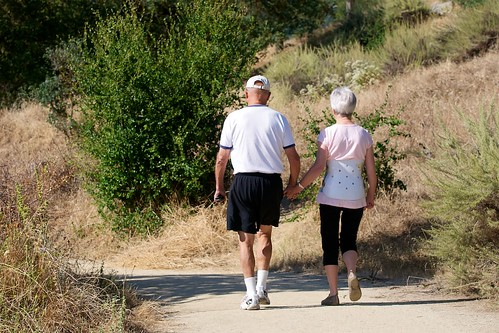 Couple walking in guadalupe oak grove park