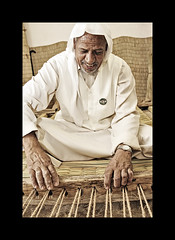 (HASAN_ADEL) Tags: old man smile canon saudi arabia tradition maker 450 smily adel ksa hasan 24105      450d       sharqiyah  jenadriyah  alestudio