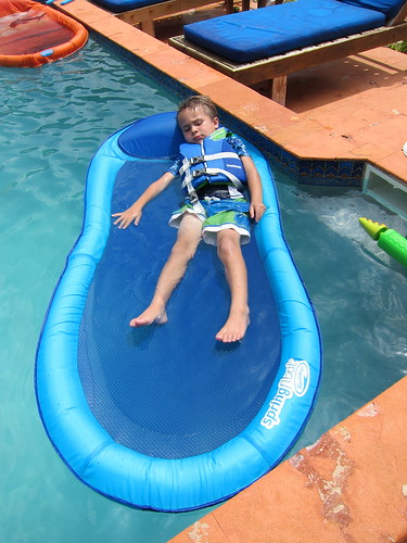 Ezra relaxes on the floaty