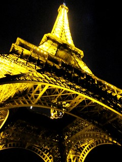 The Eiffel Tower in Paris lights up.