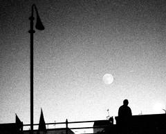 (viaggiaresiii) Tags: light bw silouette luna bn uomo notte luce controluce sera bandiere tagviaggia