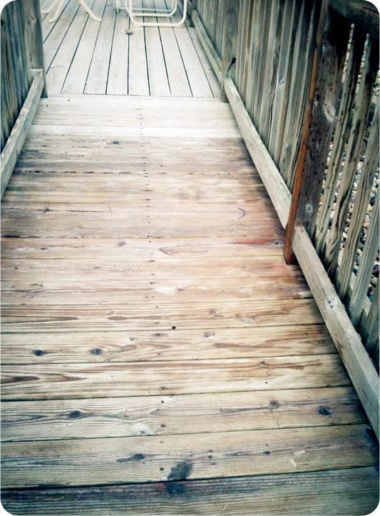 The deck's half-stained