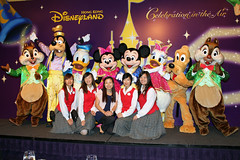 Our tour guides pose with Mickey and the gang