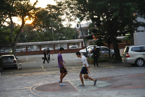 Kids playing basketball at Chung Hwa High School