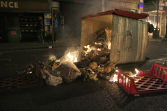 a burning bin of pinapples by againsthoping