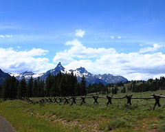 Pilot (left) and Index (right) Peaks from along Beartooth Highway in Northwestern Wyoming (danjdavis) Tags: mountains fence rockymountains wyoming beartoothhighway indexpeak pilotpeak