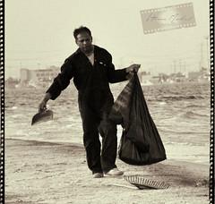Dont worry be happy ! (Hanan.Mohammed) Tags: sea bw man beach happy nikon sad tire clean mohammed worry waste fatigue 90 hanan mohammad moh dustman    d90 nno         7anan          nnoo 7ano    mohd