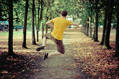 Yippee (white-and-black) Tags: park autumn trees light fun happy dance jump sandals joy corridor happiness joe run enjoy glee shout jumpforjoy