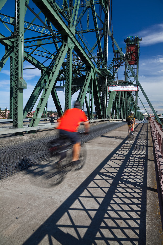 Bicycle Commuters Crossing Hawthorne Bridge in Portland, Oregon