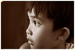 """Seek the wisdom of the ages, but look at the world through the eyes of a child"" (315Edith) Tags: boy monochrome sepia 50mm child naturallight 169 dondi 500d bwportrait facesofportraits"