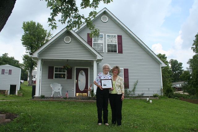 Homeowner Rita Fincher and  Missouri State Director Anita J.(Janie) Dunning in front of Ms Fincher's new house