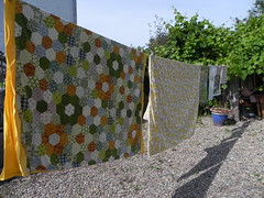 wacky washing. (Mousy Brown) Tags: flowers trees sunshine yellow vintage garden shadows line laundry photoaday 365 patchwork washing thrifty linens