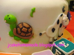 Barney and friends theme birthday cake (Jcakehomemade) Tags: fish elephant bird pig cow sheep turtle lion frog celebration birthdaycake happybirthday bj barney 2ndbirthday babybop partycake fondantcake noveltycake kidsbirthdaycake custommadecake wwwjcakehomemadeblogspotcom barneyandfriendsbirthdaycake jessicalaw jaylenesbirthdaycake