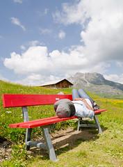 Alpine Relaxing - [EXPLORED] (andreaskoeberl) Tags: mountains alps colors girl clouds bench austria nikon lech vorarlberg arlberg mountainpasture 1685 zuers d7000 nikon1685 nikond7000 andreaskoeberl