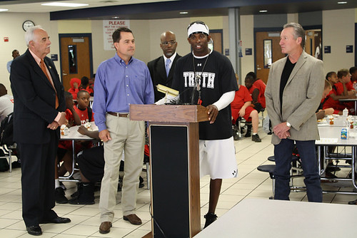 Pro Football Hall of Famer Deion Sanders promotes the Summer Food Service Program at Duncanville High School.