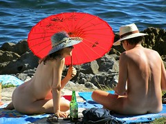 Good for Manet (vittorio vida) Tags: girls red sea people woman art beach colors hat umbrella portraits painting nude rouge landscapes couple europe outdoor croatia nudist rosso fkk painters manet istria istra funtane