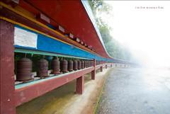 Prayer wheels, Sikkim (travelingbone) Tags: blue india mist mountain rain fog nikon buddhist goat monastery convergence tamron sikkim prayerwheels gangtok rumtek d3000 nitinpant