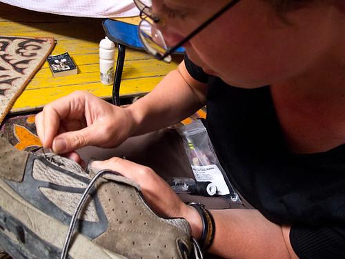 Emma repairing shoe