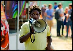 Megaphone Man (Andy Marfia) Tags: chicago iso100 volunteer f28 westloop megaphone 105mm unionpark 1800sec pitchforkmusicfestival d7000