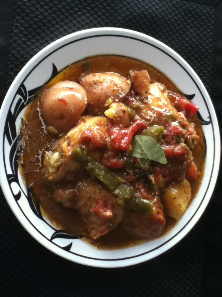 Pollo Fricassee by: The Rican Chef (Chicken in a stewed sauce) with potatoes.