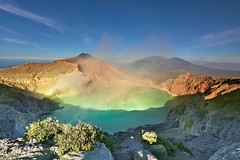 The world's largest acidic volcanic crater lake, Ijen Crater. (tropicaLiving - Jessy Eykendorp) Tags: morning blue light plants mountain lake green nature canon indonesia landscape photography eos volcano nationalpark outdoor top smoke acid peak hike mount crater lee sulphur filters rim acidic 1022mm surabaya bromo semeru tengger eastjava 50d ijen tuquois banyuwangi bondowoso nextbest8