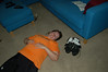 Exhausted (nateOne) Tags: orange iso200 shoes cyclist floor tshirt nikond50 couch tired schnivic lying exhausted wornout 19mm 1855mmf3556 160secatf35 focusdistance