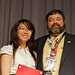Team Canada-MILSET member Joy Liu receives an award to participate in I-SWEEEP 2012 in Houston, Texas from Don Howk of MILSET USA.