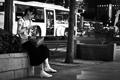 Waiting (Woods | Damien) Tags: street blackandwhite girl night contrast dark waiting shanghai noiretblanc chinese streetphotography   rue nuit rafflescity peoplessquare  canonef50mmf18ii canoneos60d