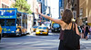 Hailing in the city (modenadude) Tags: street city nyc shadow woman sun newyork girl hail bag focus pretty dress arm bokeh cab taxi fingers midtown transportation daytime behind stretched 16x9 sightsee hailing