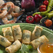 Shrimp spiced with hot chilies, curry and cilantro marvelously wrapped in a spring roll with a cilantro leaf accent.