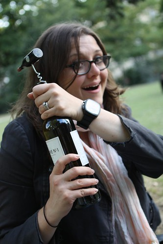 Jen Opening the Wine at the Champ de Mars