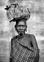 Mursi woman in Jinka - Omo Ethiopia (Eric Lafforgue) Tags: woman eyes artistic shaved culture tribal ornament clay tribes lip bodypainting tradition tribe ethnic rite mago mursi jinja bodymodification tribo labret adornment pigments ethnology tribu eastafrica thiopien etiopia ethiopie etiopa maggo 2594 levre  etiopija ethnie ethiopi  lipplug etiopien etipia  etiyopya  rasee nomadicpeople         peoplesoftheomovalley lipdisclipplate piercedhole piercedlipornament