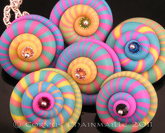 Spinners (Redcrow at Corvus Chainmaille) Tags: colour silver spiral beads crystal handmade jewelry jewellery clay handcrafted sterling swarovski spinner pendants polymer ketztx4me