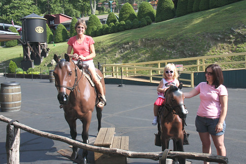 Riding plastic horses