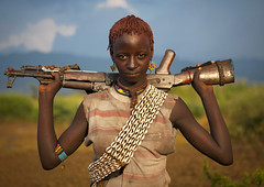 Bana girl with gun - Omo valley Ethiopia (Eric Lafforgue) Tags: woman shells girl beauty bena gun arm artistic culture tribal ornament tribes bodypainting tradition tribe ethnic rite bana tribo adornment pigments ethnology tribu banna eastafrica 2025 thiopien etiopia beaute arme ethiopie etiopa benna  etiopija ethnie ethiopi  etiopien etipia  etiyopya  nomadicpeople         peoplesoftheomovalley