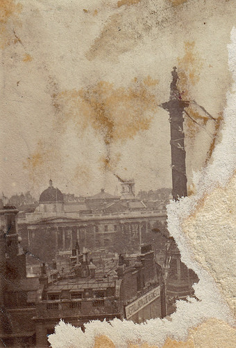 Trafalgar Square, London. Nelson's column wrapped in a garland. But why and when?