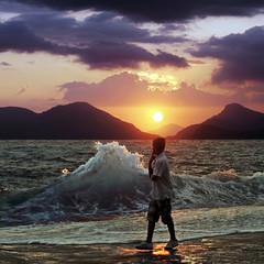 SANCTIFIED (kenny barker) Tags: boy sunset sea sun mountains turkey landscape surf wave panasonic g1 scape legacy tqm oludeniz