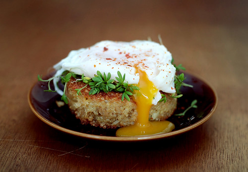 Quinoa cakes with poached eggs and sprouts