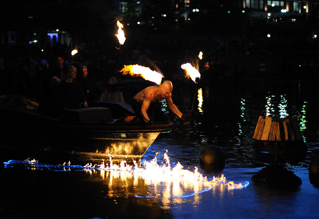 Waterfire Guy Setting His Boat On Fire