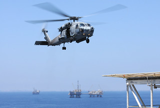 An HH-60H Sea Hawk helicopter prepares to land...
