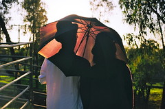 you and me always between the lines (maxwell.dunn) Tags: friends sunset shadow party tree film halloween leaves silhouette umbrella interesting bokeh peterpan romance explore forever canonae1 frontpage americangirl